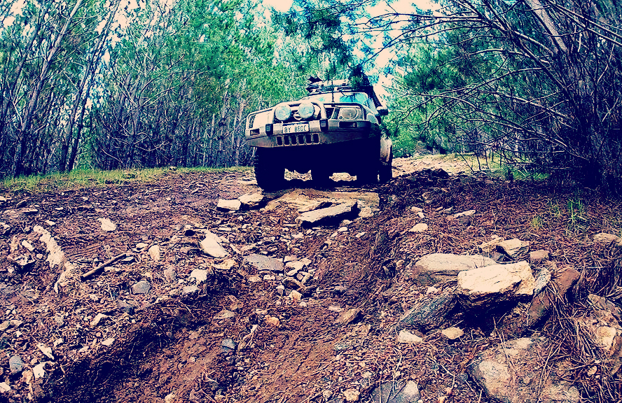 A 4WD driving off road going to a camp site