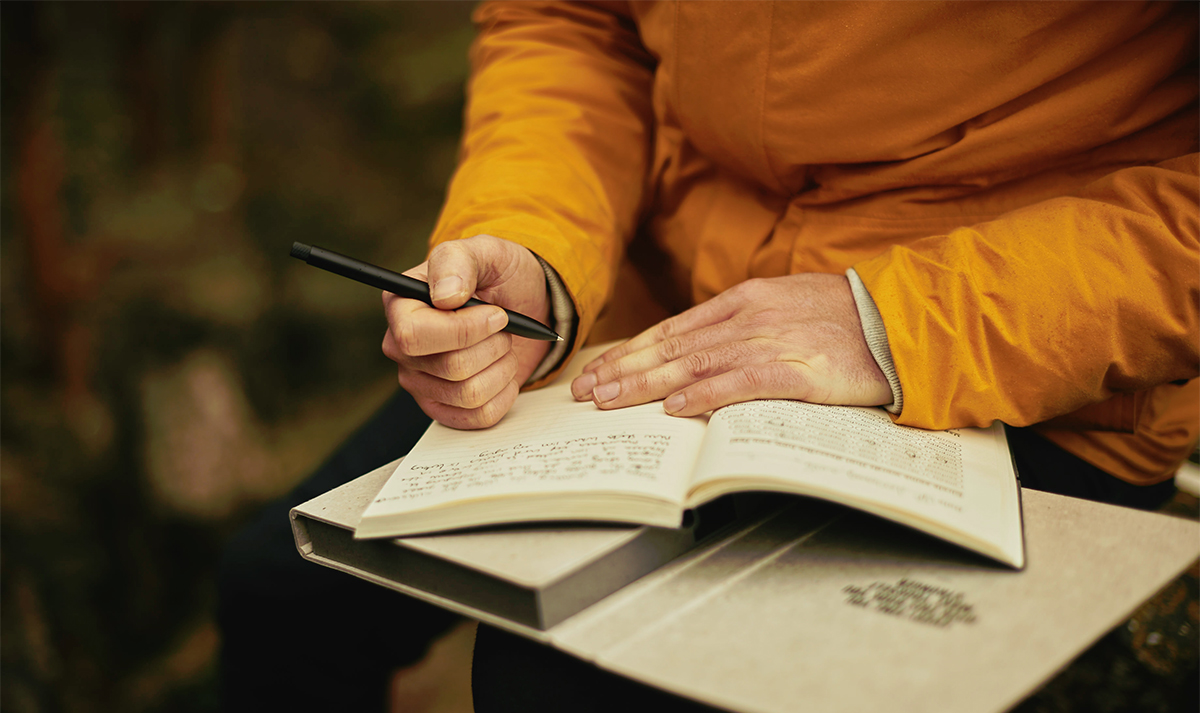 Writing in a journal whilst travelling around the world