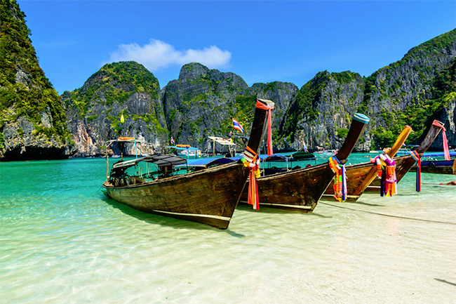 Boats on a beautiful beach in Thailand