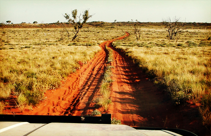 4WD tyre trails on a dusty off road track