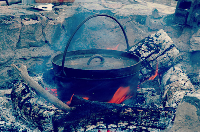 Camp oven burning over open fire